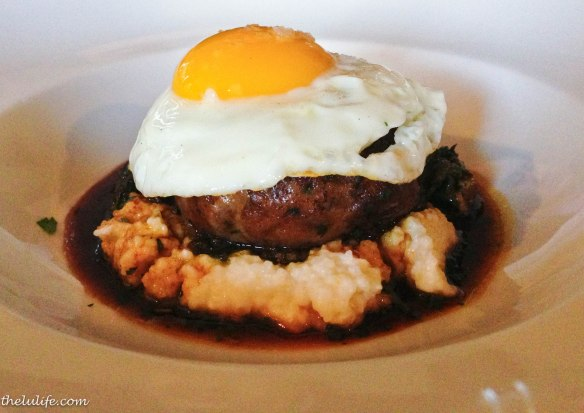 Figure 5. Whole hog crepinette, cheese grits, piggy sprouts, natural maple jus and sunny side up egg