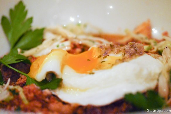 Figure 6. Kitchen Sink Cassoulet topped with a poached egg that we had just broken into