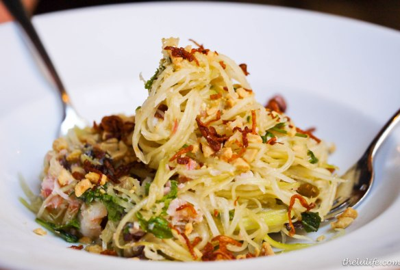 Goi du du: Green papaya salad with shrimp, pork belly, house made jerky, peanuts, fried shallots, herbs and nuoc cham