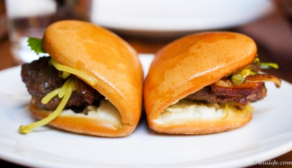 Lamb burger banh bao with curry bean sprouts, mint, parsley and jalapeno jelly