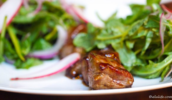 Lamb luc lac - lamb tenderloin with oyster sauce, red onions, arugula and French breakfast radishes