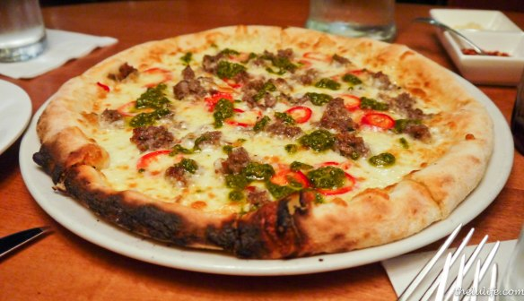 Housemade lamb sausage fresno peppers, Caciocavallo cheese and mint pesto white pizza We avoided the burnt marks, but otherwise, we loved the tiny, spicy kick at the end of every bite.  Plus, this pizza wasn't swimming in grease =)