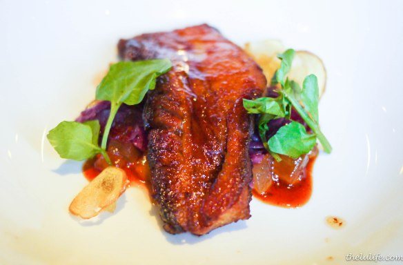 Glazed pork belly with spiced apple compote and braised cabbage